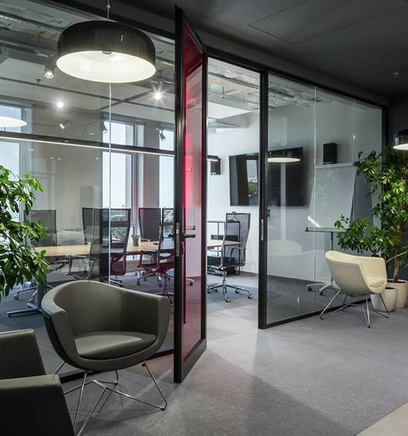 Interior Glass partitions are great for passing sunlight in modern offices like this one.