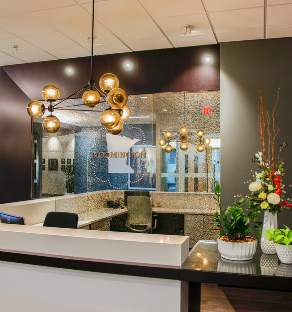 GlassArt Designs provided the stunning custom antique mirrored glass panels that sit behind the information desk at Bloomington Convention & Visitors Bureau.