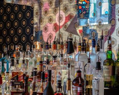 Close up view of the custom antique mirror bar back by GlassArt Design at Nye's Bar in NE Minneapolis.  Photography Credit: Lava Submarine