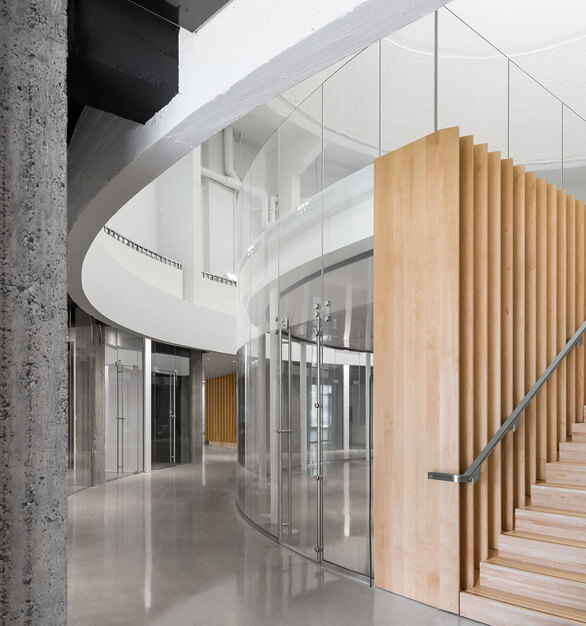 Glass walls and railings maximize interior lighting and create a comfortable environment to collaborate.
