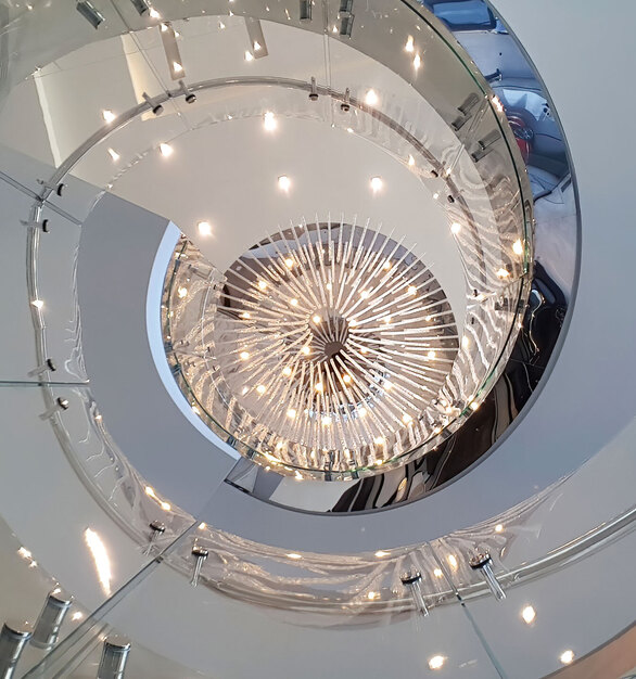 We provide a laminated and toughened (tempered) product that can also be curved. This can eliminate the need for handrails and is certified compliant with the local council and building regulations. Even if both layers of glass are broken, the structural laminate will not fold over or tear whilst subject to an average person's weight pushing against it.