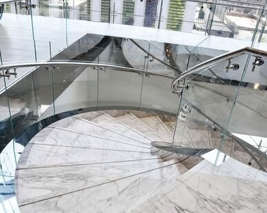 Curved glass balustrades (railings) are a safe and easily maintained surface that delivers superior performance and aesthetics. A curved staircase could be the architectural focal point in any interior space.