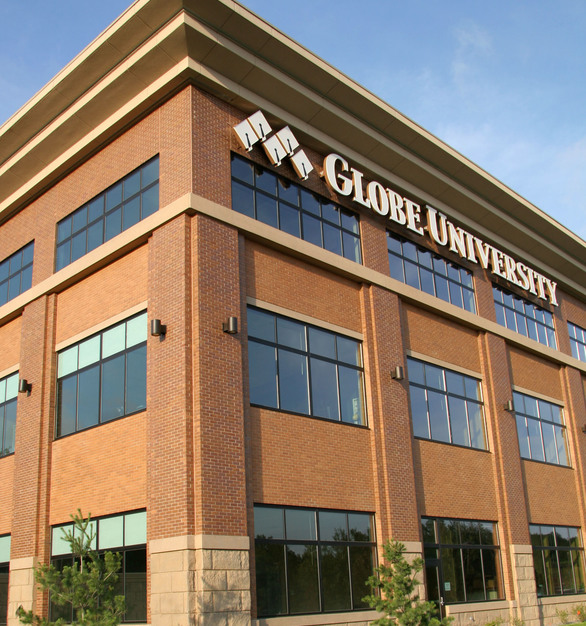 Exterior of Globe University by Wells Concrete. This project included architectural and structural wall panels, beams, columns, double tees, stairs, formliners, and thin brick facade with an acid etch and sandblast finish.