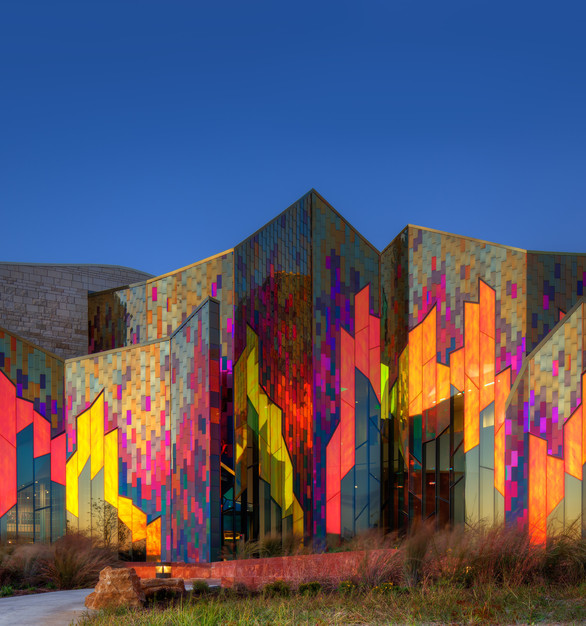 The Prairiefire museum was designed by Verner Johnson Architects and Planners after it's namesake: the Kansas prairie fire. Goldray Glass's color-changing dichroic glass was used in the insulated glazing unit to mimic the flickering flames.