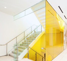 Golden Yellow Laminated Glass Wall Panel next to Staircase at City Market at O Street in Washington, D.C.