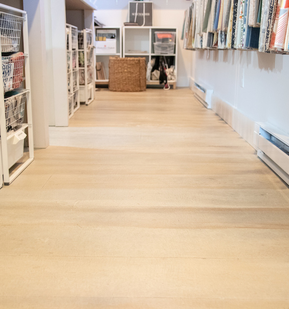The flooring shown here provided by Granicrete used an 8-inch wide plant look to mimic wood flooring.