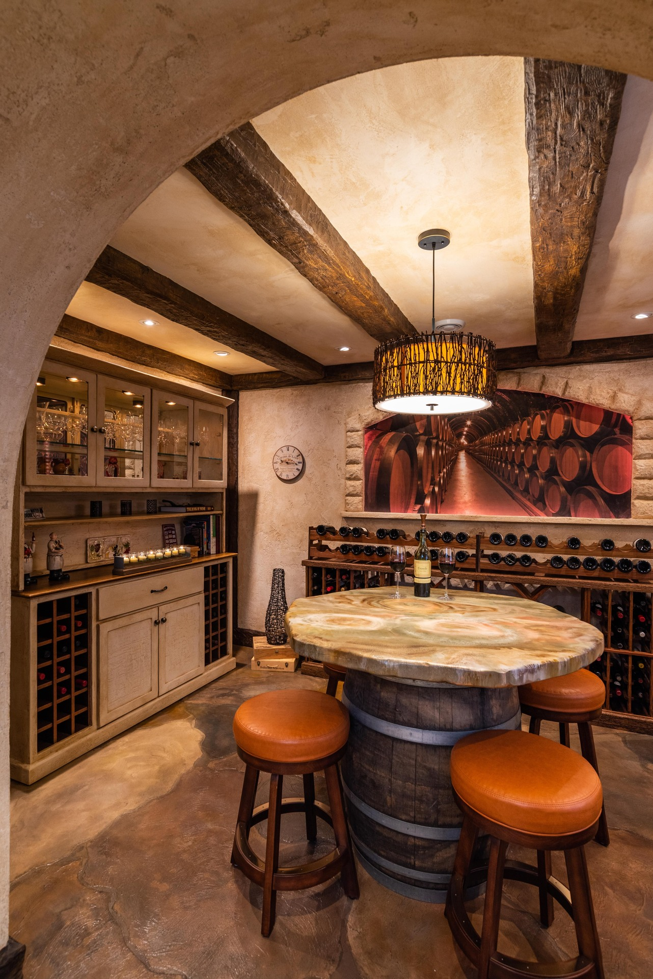 Stunning wine room featuring flooring and table top by Granicrete Minnesota.  Photographer: John Walsh