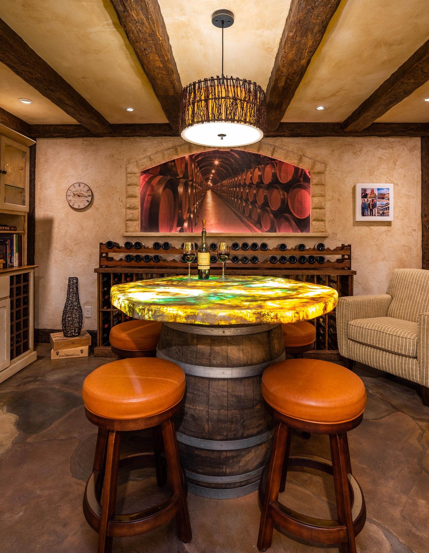 Custom flooring with a custom tabletop to match the space within this wine room.  Photographer: John Walsh