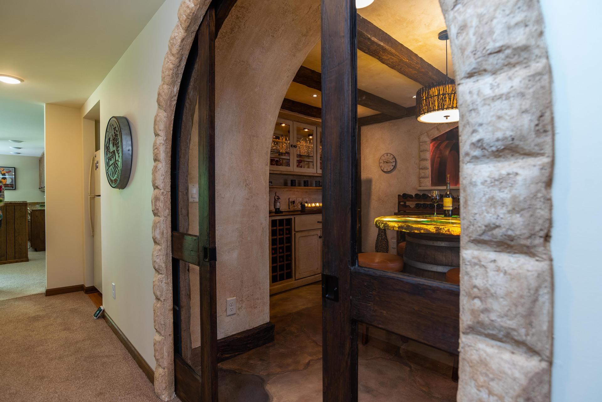 Custom flooring designed by Granicrete Minnesota for this spacious wine tasting room.  Photographer: John Walsh