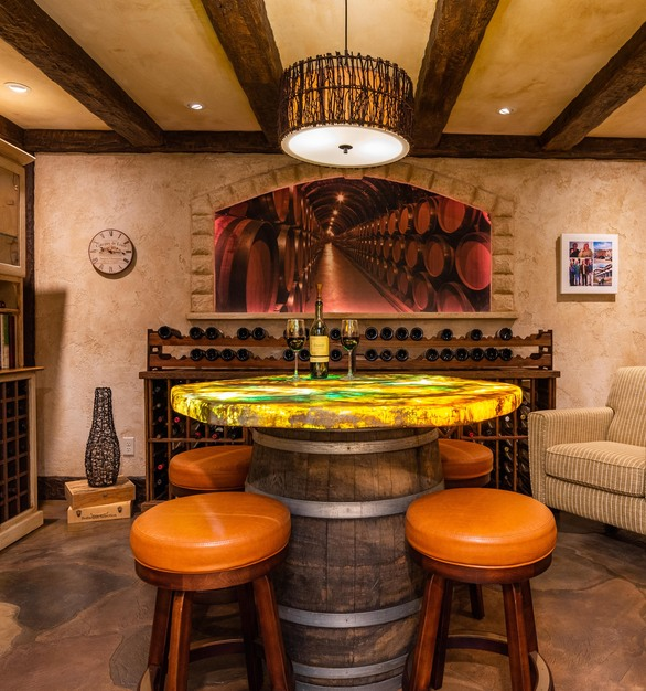 Custom flooring with a custom tabletop to match the space within this wine room.
