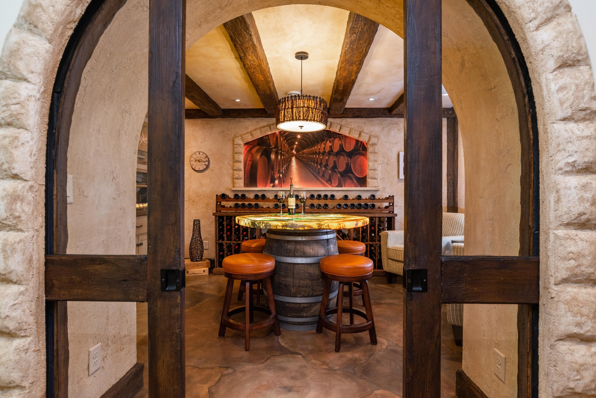 A custom wine room for tasting showcases flooring and a tabletop by Granicrete Minnesota.  Photographer: John Walsh