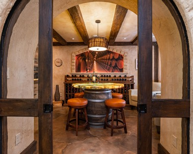 A custom wine room for tasting showcases flooring and a tabletop by Granicrete Minnesota.