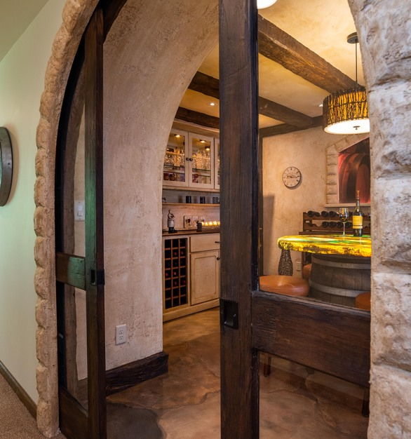 A beautiful archway leads into a wine tasting room that boasts custom flooring and tabletop by Granicrete Minnesota. 