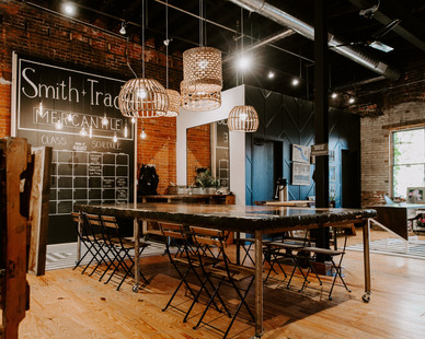 In Stillwater, Minnesota is Smith + Trade Mercantile which showcases a custom table with concrete overlay designed by Granicrete Minnesota.