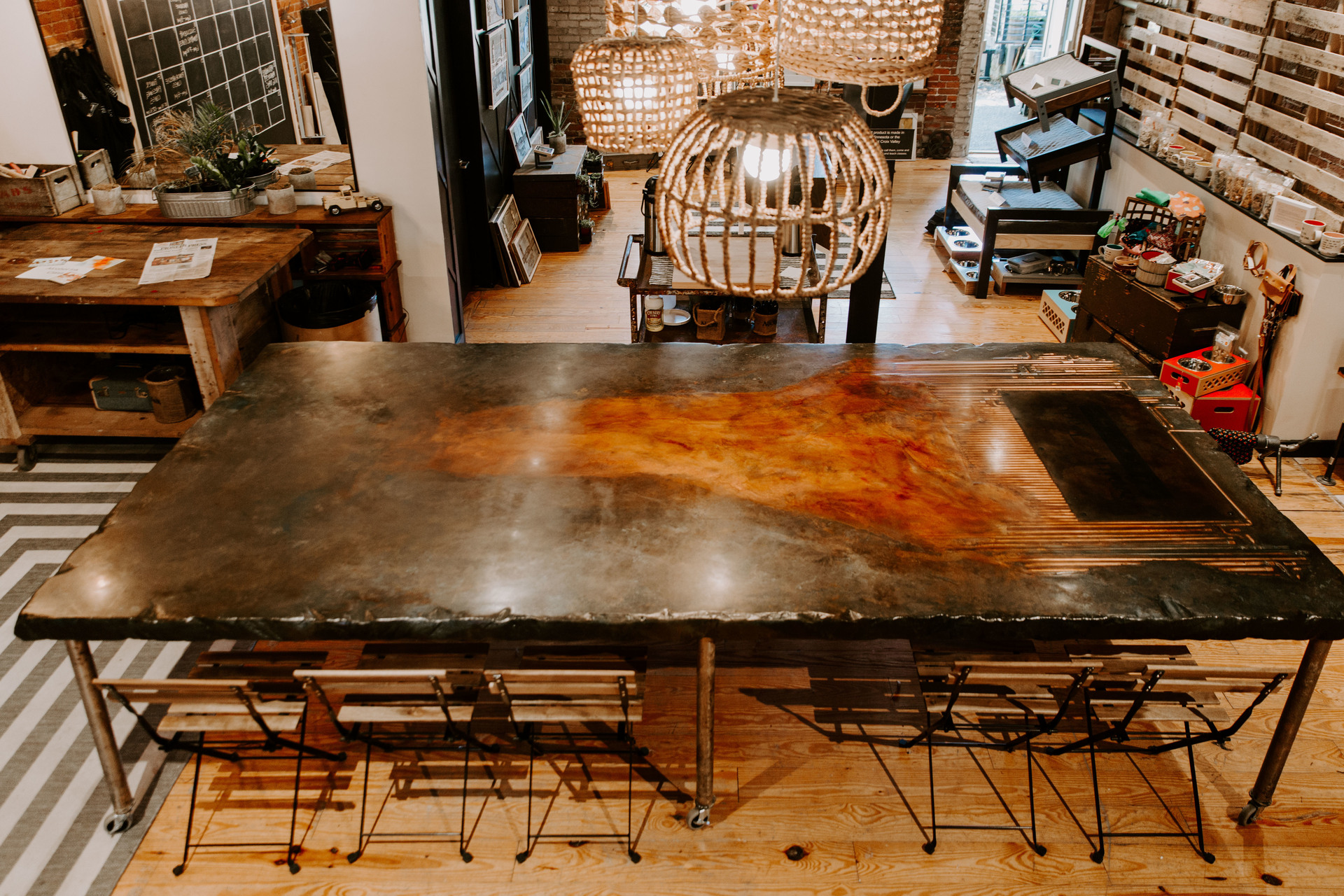 Eclectic interior design at Smith + Trade Mercantile in Stillwater, Minnesota showcases the stunning tabletop designed and created by Granicrete Minnesota.