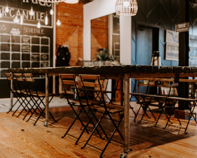 Eclectic interior at Smith + Trade Mercantile in Stillwater, Minnesota showcases the stunning tabletop designed and created by Granicrete Minnesota.