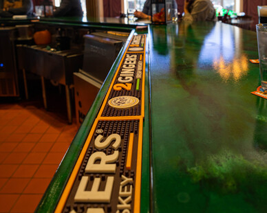 The historic Charlie's Irish Pub and Restaurant received a facelift when the new horseshoe bar and drip plate were installed. This countertop was the perfect fit both literally and metaphorically. Physically, it fit the space perfectly and was the largest horseshoe countertop created without seams. Metaphorically, Granicrete's NSF certification and ability to heat up to 500° fulfilled the needs of the Pub.