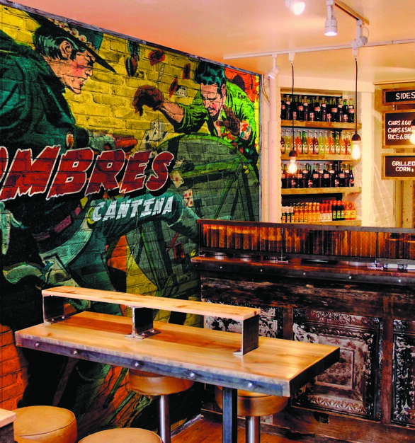 This fun and bright graphic wall art makes a great conversational piece at this cantina.
