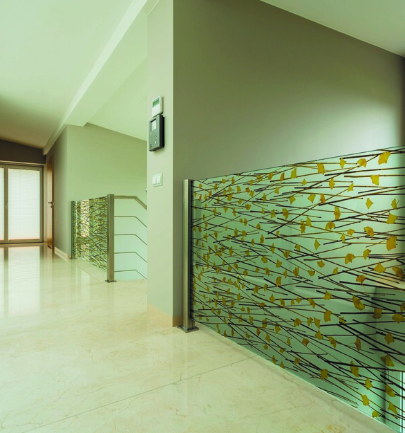 Walk down this hallway and admire the glass graphic panels that allow light and provide safety to all who use it.