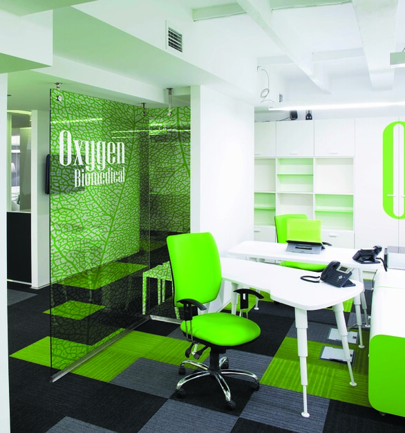 Use your brand colors in this bright and open office.  The glass graphic partition is a great way to add definitions to the space, but still keep the feeling of a big space.