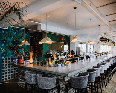 Wilkus Architects created a tropical and inviting commercial bar design at the Hai Hai Bar