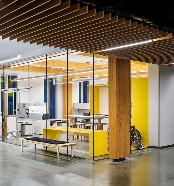 Hallway Polished Concrete Floors Wood Ceiling Acoustical Baffles Glass Architectural Frameless Walls