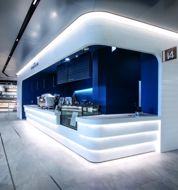 Hanex Clara was used for the construction of this cafe kiosk. The modern white finishes of Hanex Solid Surfaces complement the modern design of the space.