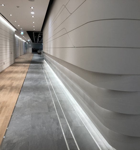Boring hallway? Up the design and finish by including Hanex solid surfaces into your interior space.