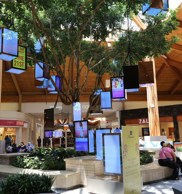 The color-changing, frameless LUXFIT™ RGB LED Light Panels hang from the tree in the shopping mall atrium. The space adds warmth and a fun ambiance to the mall, and the benches are the perfect spot to sit and take a break from your shopping trip.
