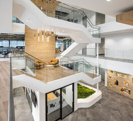 Hanging Pendant Cylindrical Lights in Open Office Atrium