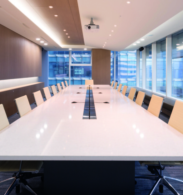 A large conference room table using HanStone Quartz by Hyundai L&C USA.