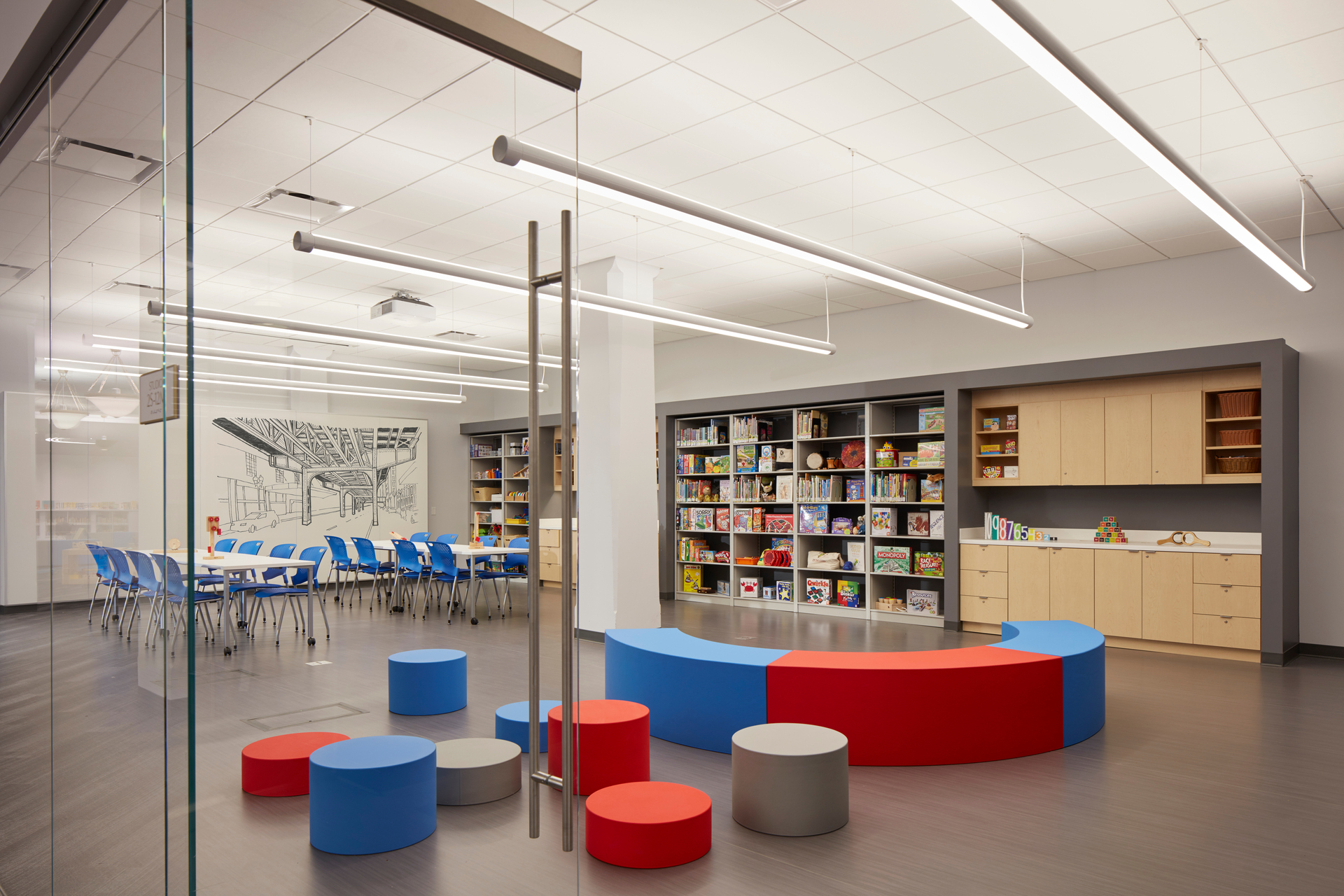The Chicago Public Library was constructed in 1873. As a Chicagoland Historical Landmark the building has gone through several renovations during its lifetime.  Our In Floor Cellular Raceway System was implemented during one of the library renovations that took place in the late 1980's.  These beautiful photos are of the 2017 remodel which is now the Harold Washington Children's Library Center. It'sjust one of the projects that demonstrates that that our system holds up to the test of time.  © Tom Harris | Design by Gensler