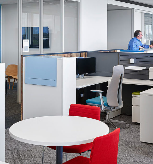 The open workspace design at the Dairy Farmers of America headquarters created a community-oriented culture, allowing coworkers and employees versatility on how they collaborate and work.