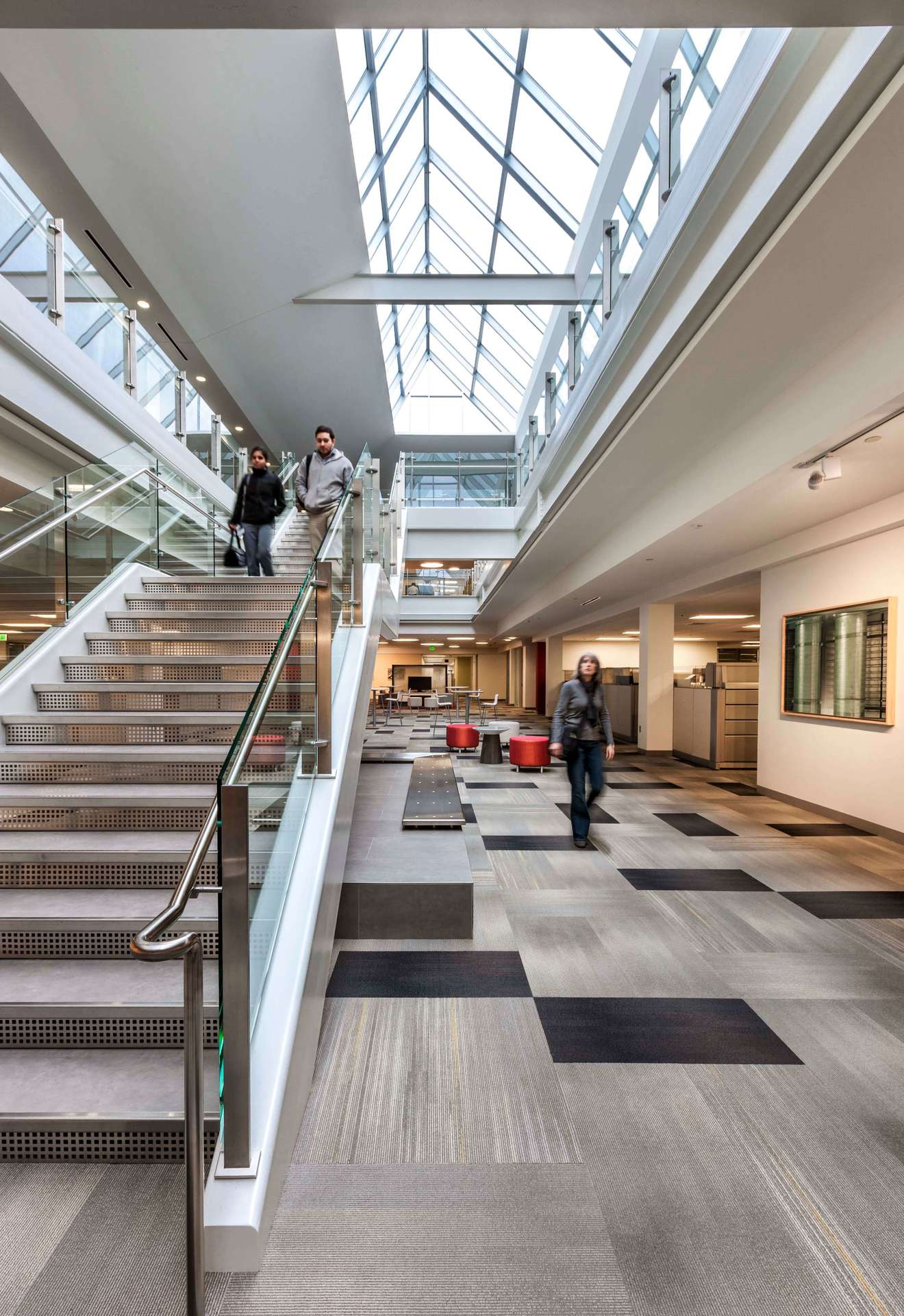 The large skylight illuminates the space with natural light at the CPG Corporate Office in Shoreview, Minnesota, by HCM Architects.