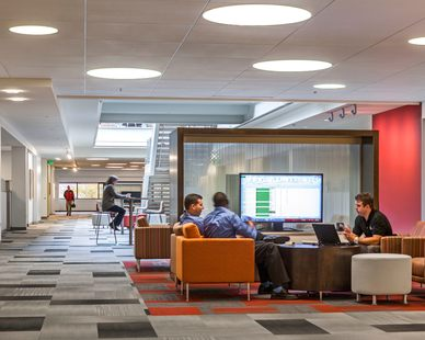 Open office space environments encourage collaboration and teamwork at the CPG Corporate Office in Shoreview, Minnesota, by HCM Architects.