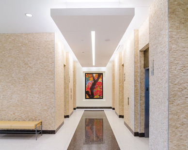 An elegant elevator lobby at Mercy Hospital featuring the CX Continuous Cove indoor luminaire. This lighting fixture provides soft, uniform, illumination for contractor and extruded coves.