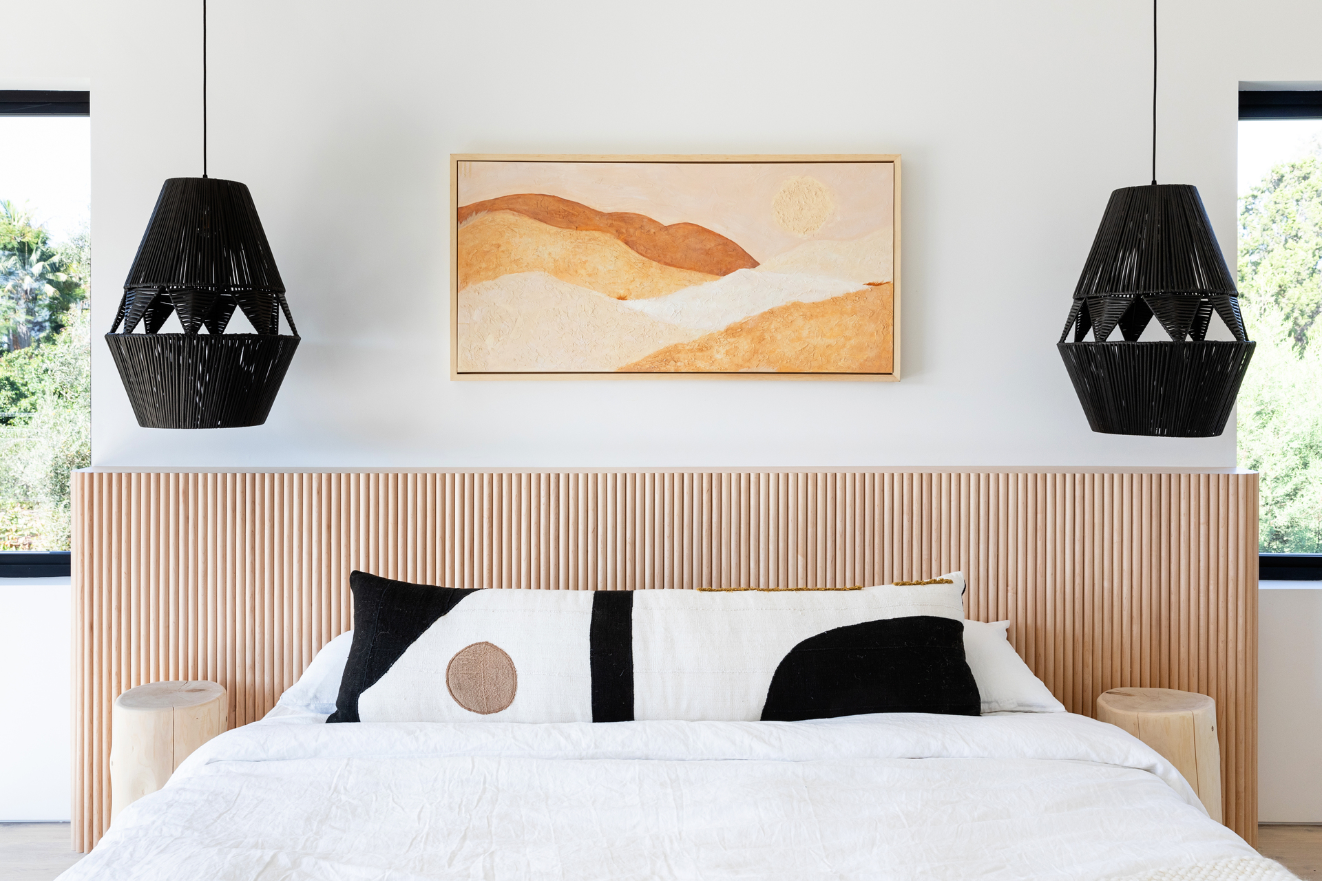 The wicker hanging pendant lights accent the gorgeous tambour solid wood headboard. Solid wood tambour panels provided by Surfacing Solution. Panels can be stained to match any design.