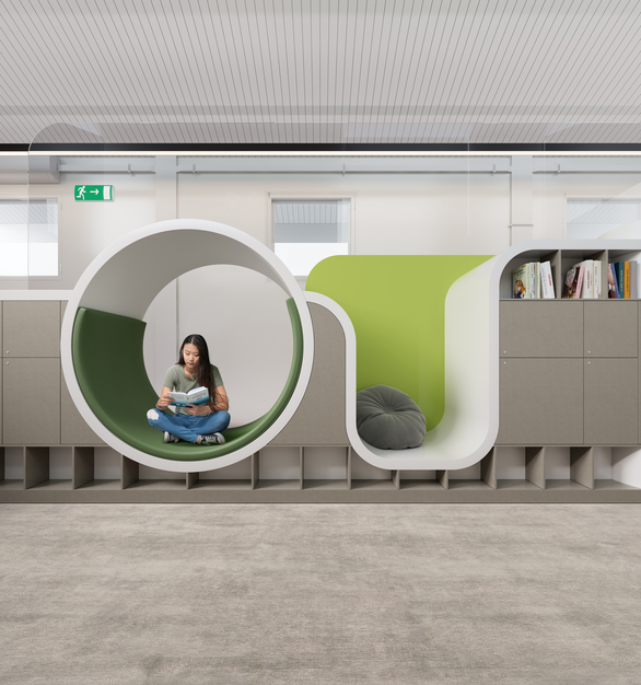 The reading nook in a healthcare space features Durasein's solid surface material in Arctic White, Concrete, and Grape green.