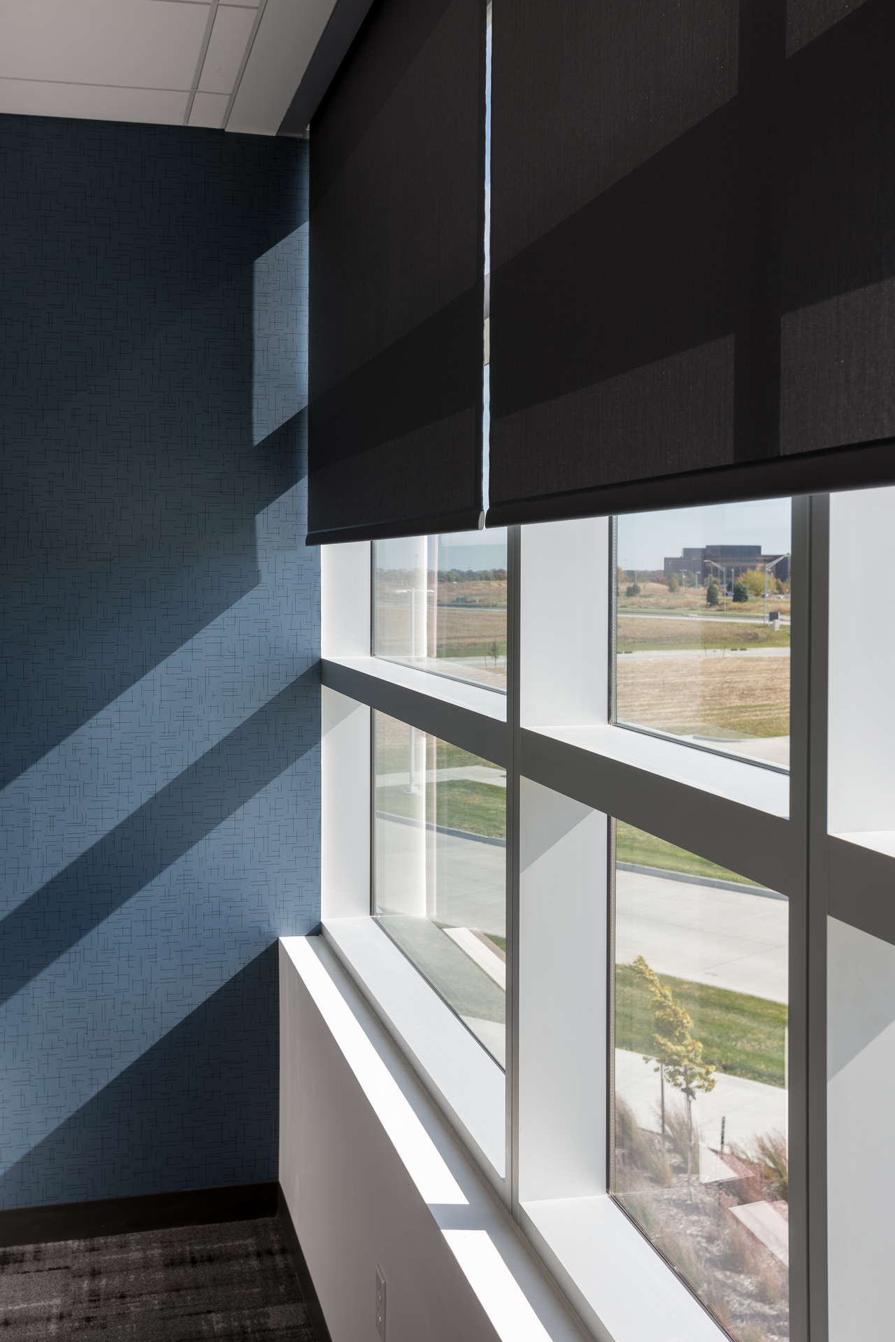 Smart shading systems by Lutron makes darkening a room easy and convenient. Photography by Alex Benge.