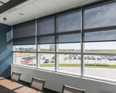 Smart shading systems make it easy to allow just the right amount of natural light into any space. While all the way down, you can still have visibility of the outside. Photography by Alex Benge.