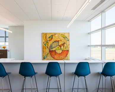 The different workspace areas provide versatility and choice to where employees can work and collaborate. Expansive windows allow natural light to fill the space and promote a healthy work environment. Photography by Alex Benge.