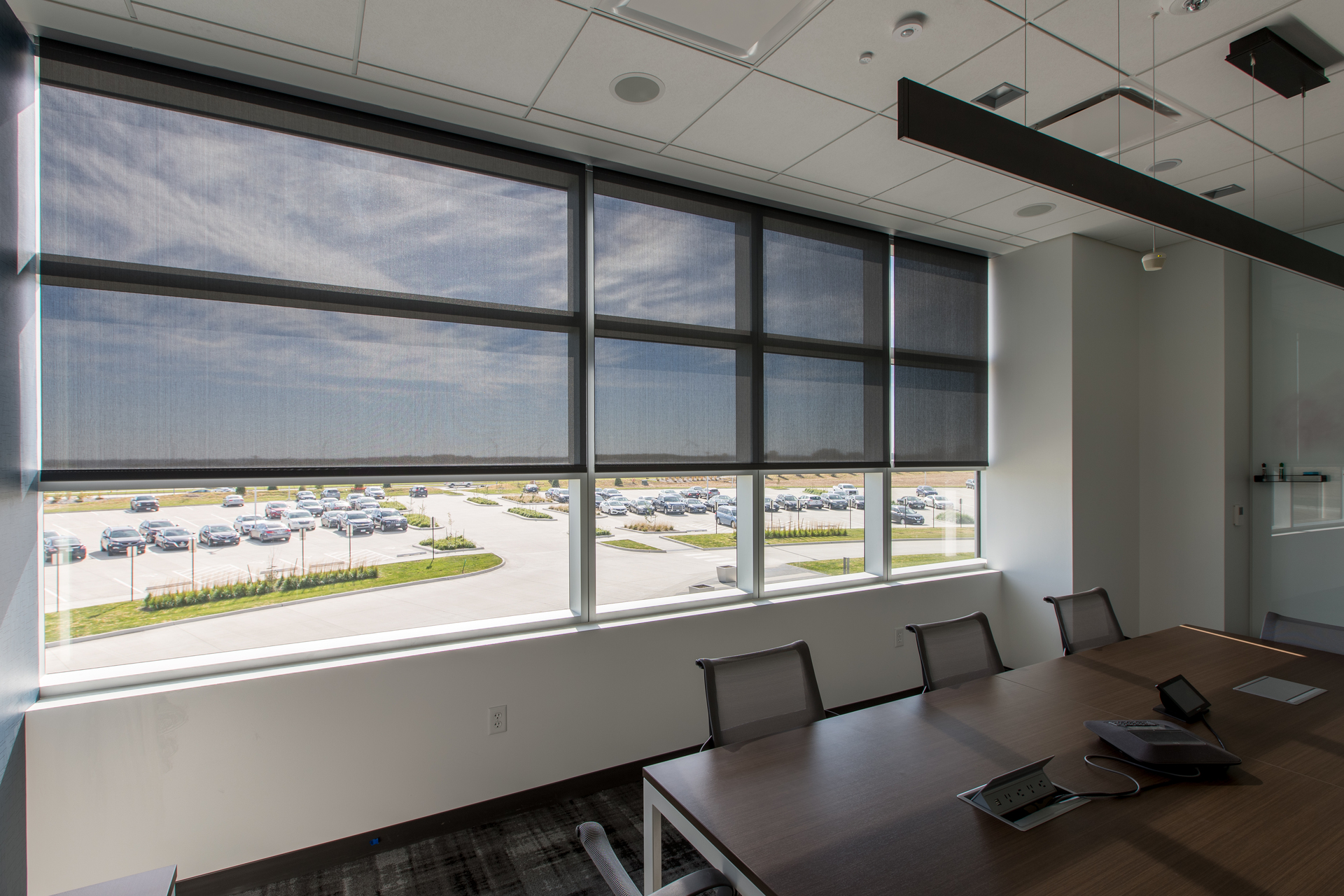 Bright or shaded, your choice! Smart shading systems make it easy to allow just the right amount of light in your small meeting room. Photography by Alex Benge.
