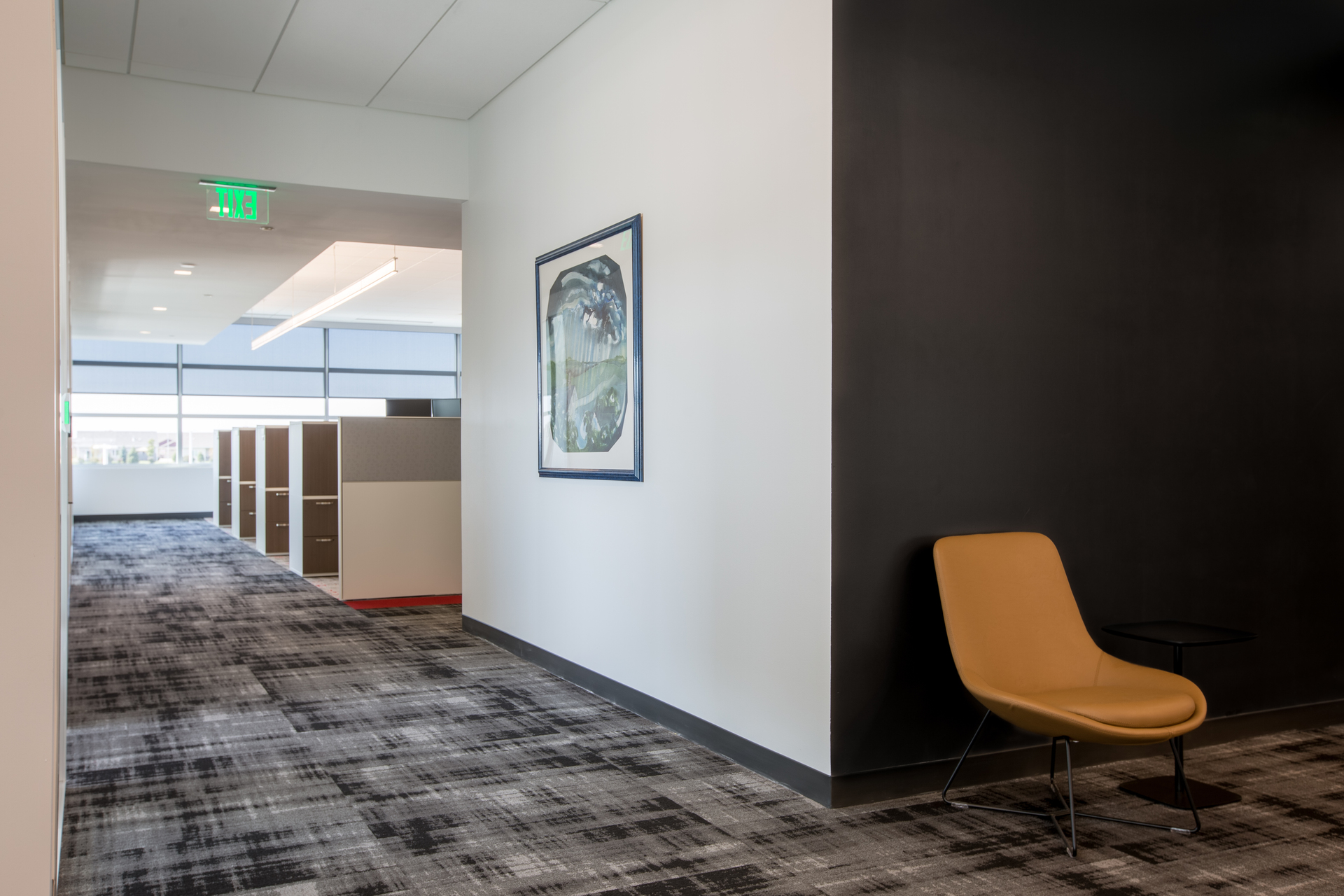 Spacious office hallways provide easy traffic flow between rooms and spaces at the IMT HQ in West Des Moines, Iowa. Photography by Alex Benge.