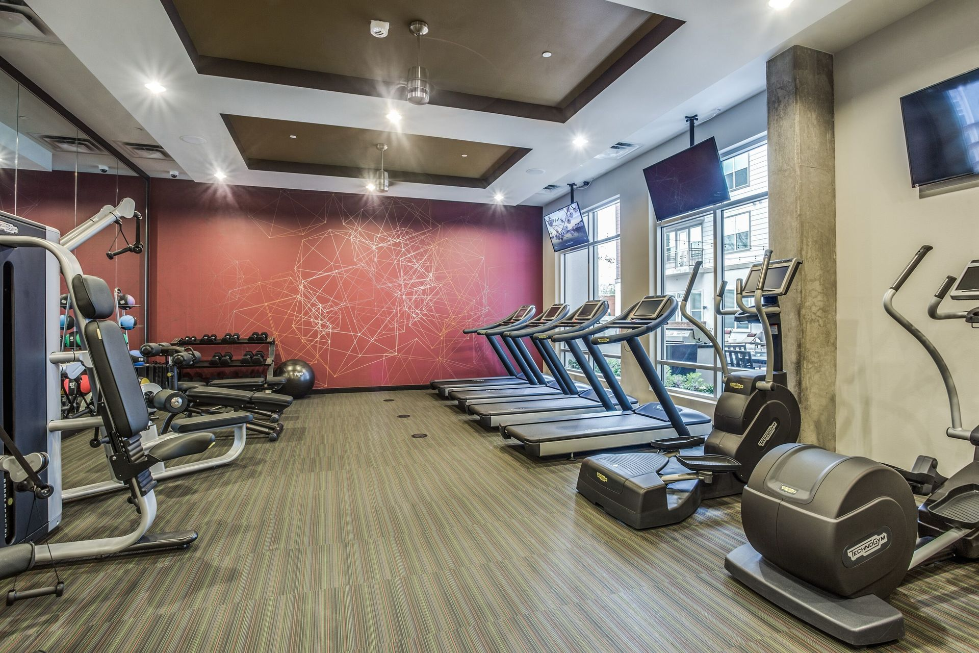 A motivating fitness center at this up-scale apartment complex in Dallas, TX, by Hensley Rachel Lamkin.
