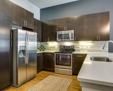 This apartment complex has kitchens that are equipped with quartz countertops and designer backsplash and 