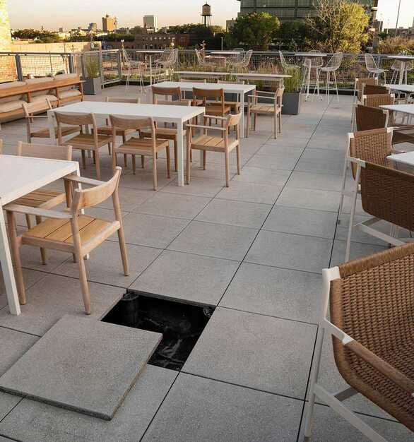 Herman Miller outdoor terrace raised access flooring with STONEWORKS Classic Concrete outdoor panels