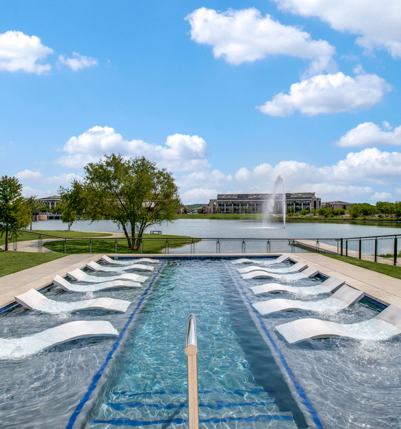 Relaxing pool at The Hudson Apartment and Townhomes located in Colony, Texas by Hensley Lamkin Rachel, Inc.