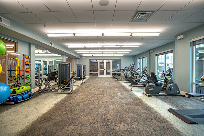 Fitness room at Overture in Plano, TX, by HLR Architecture.