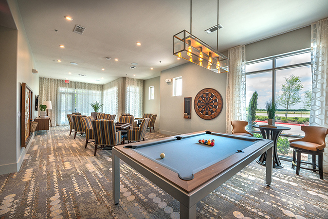 Gaming room for the residents at Overture in Plano, TX, by HLR Architects.