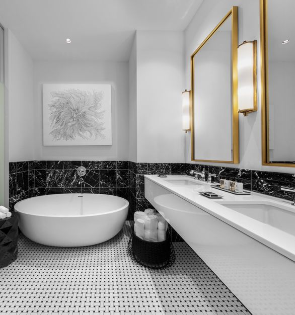 Luxurious oversized bathroom with a soaking tub at Hotel Alessandra located in Houston, TX.